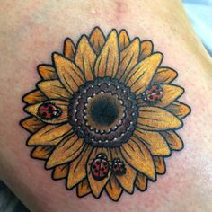 Sunflower with ladybugs tattoo. By Brandy Pouliot at Twisted Anchor Tattoo in Ocean Springs, MS