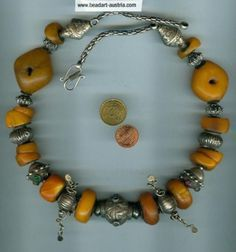 Antique Mauritanian amber combined with antique silver beads from India and Turkmenistan.  |  BeadArt Austria Design | 1800 Euro