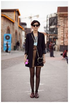 Striped shirt, black trench, brown skirt/shorts, tights, brown loafers. Katerina by streetgeist, via Flickr