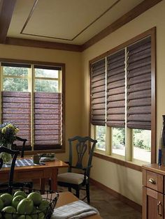 Roman shades allow homeowners to enjoy the beauty of draperies with the ease of use of a blind. The Roman shades pictured here feature Top-Down/Bottom-Up operation allowing the homeowner to allow light in while preserving privacy. Top-Down/Bottom-Up is a good choice to cut glare without sacrificing natural light in television rooms. @budgetblinds.com