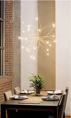 Design Crush » Random Orbit.  This one keeps getting pinned as wire hangers and christmas lights. It's definitely not. This fixture is $1800. I'm sure you could pull off a decent replica with those items, though...