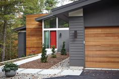 mid century exterior colors... natural wood accents, shades of grey, white, burnt orange