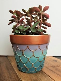 flower pots outdoor Learn how to make your own DIY mermaid flower pots with Texture Powder, Metallic Cream, and All-in-One Decor Paint! Step OneSeal the inside of your unpainted ter Mosaic Flower Pots, Mosaic Pots, Flower Planters, Diy Planters, Plastic Planters, Painted Plant Pots, Painted Flower Pots, Painting Terracotta Pots, Painted Pebbles
