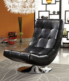 """Trinidad contemporary style black leather like vinyl hammock style tufted swivel scoop chair with chrome base.  Chair measures 24"""" x 35 1/2"""" x 35"""" H.  Some assembly required."""
