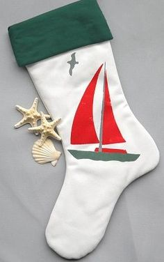 Each stocking measures 24 inches from upper right cuff to toe tip. Hand made in the USA. Coordinating hand-painted tree skirts also available. Please allow 2-weeks for delivery. We recommend ordering by Dec. 1st to ensure delivery by Christmas. #HH-CB08-STCoastal Christmas Sailboat Stocking