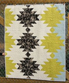 Update:  This quilt pattern is now available here in my shop! This quilt has been sitting completely finished for at least a year.  Here is it's story.  Once upon a time when the whole 'tribal' trend