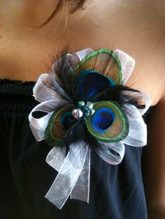 peacock feather corsage for the Moms