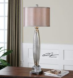 Uttermost Loredo Mercury Glass Table Lamp. Fluted mercury glass with brushed nickel plated details and crystal accents. The round hardback is a silken champagne bronze fabric.