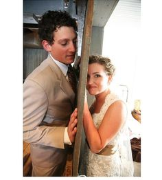 before the wedding, get pictures of the bride and groom on either side of a door. you get pictures together but dont actually see each other before the wedding!