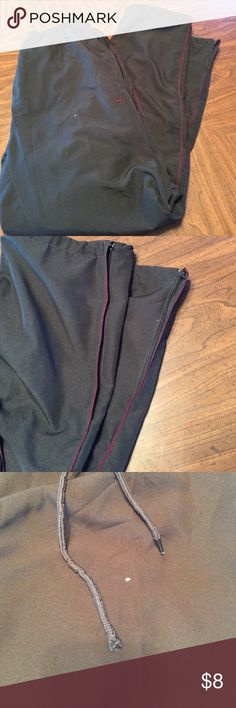 "Men's Black with burgundy accents. Light weight but very warm! Ankles have zippers and pull string. Also water resistant material on inside of ankles. 2 small flaws. 1 tiny hole in front does not go through both layers and 1 of the waist strings for waist is missing end cap. Price reflects. Total length from waist to pant cuff 43 1/2"" tag height reads 183? Nike Pants Sweatpants & Joggers"