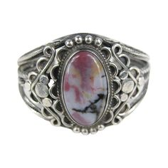 Old Pawn Navajo Sterling Silver Purple Hue Petrified Wood Bracelet | From a unique collection of vintage cuff bracelets at https://www.1stdibs.com/jewelry/bracelets/cuff-bracelets/