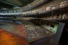 'Long Shadow of Chernobyl': On April 26, 1986, operators in this control room of reactor No. 4 at the Chernobyl Nuclear Power Plant committed a fatal series of errors during a safety test, triggering a reactor meltdown that resulted in the world's largest nuclear accident to date. Today, the control room sits abandoned and deadly radioactive. Chernobyl Nuclear Power Plant, Ukraine, 2005 (Gerd Ludwig/INSTITUTE)