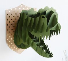 Build a 3D Dinosaur with the easy paper cutting compatible with the Cricut Explore.