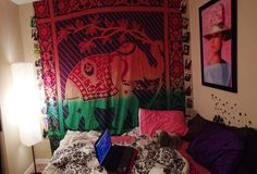 My bedroom design still in progress, elephant tapestry from Urban Outfitters, and pictures all down the sides!