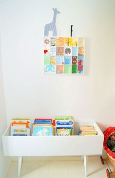 Book Bin using a drawer with some short legs attached. (Found here: http://www.handmadecharlotte.com/8-clever-book-storage-display-ideas/#more-33889  ; Originally from here:  http://dejligheder.blogspot.com/2011/09/brnebibliotek-i-stedet-for-seng.html
