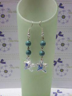 Swarovski pearl + star fish earring.