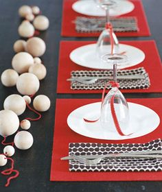wooden baubles/red table setting via Real Simple