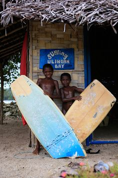 two young surfers in papua new guinea pose with broken surfboards left behind by travelling surfers Gudmundur 'Gummi' Fridriksson Blog http://www.gudmundurfridrikssonblog.com/undiscovered-waves-surfing-png/