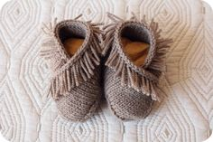 I simply could not resist knitting up these sweet tiny moccasins for a friend of mine who is expecting.  The pattern is called Welcome Mocs and is included in the adorable new booklet, New Guy, by des