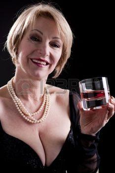http://us.123rf.com/450wm/stefanolunardi/stefanolunardi1103/stefanolunardi110300175/9051933-happy-mature-woman-with-drink.jpg?ver=6