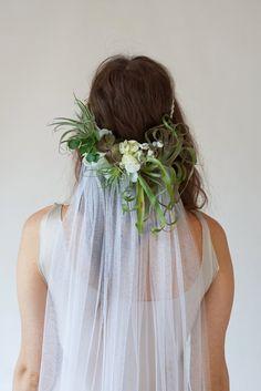 Beautiful succulents & air plants make up this unique half crown & veil combo