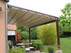 Gibus Group, leader in the production of awnings and pergolas for sun protection and energy saving Save Energy, Backyard, Outdoor Structures, Landscape, Garden, Outdoor Decor, Future, Home, Patio