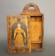 A century Pine hanging candle box with original painted decoration depicting a woman carrying two pails. Shaped back with hanging hole and slide lid. Original painted finish with some wear, ed. Antique Paint, Antique Decor, Antique Wood, Antique Furniture, Primitive Painting, Painting On Wood, Antique Boxes, Antique Frames, Painted Boxes