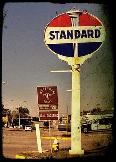 Standard Oil. On trips, my dad and sisters and I each picked one gas station to count. Esso, Gulf, Sinclair--whoever counted the most won. We didn't always have interstates, and the routes we took went thru little towns.