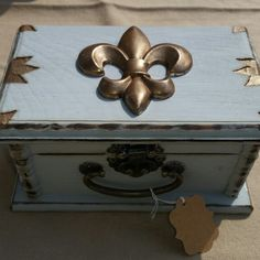 Wood box in blue chalk paint with bronze details and wood burned details.