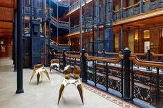 """The Los Angeles– and Beijing-based Gallery ALL displayed three pieces from Zhoujie Zhang's 2014 """"Brass Collection"""" — from left, the Brass Spider Chair, Brass Heart Chair and Brass Split Chair — at its L.A. outpost in the landmarked Bradbury Building. Photo by Weldon Brewster"""