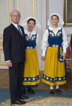 (L-R) King Carl XVI Gustaf, Queen Silvia and Crown Princess Victoria during the National Day reception 2014 at the Royal Palace of Stockholm