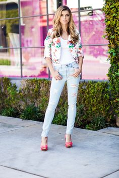 Ripped denim adds the perfect amount of edge your flirty florals.