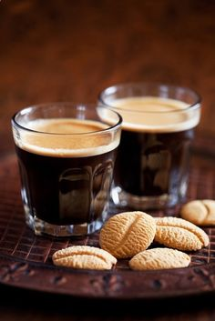 Espresso - coffee brewed by forcing a small amount of nearly boiling water under pressure through finely ground coffee beans. Espresso is generally thicker than coffee brewed by other methods, has a higher concentration of suspended and dissolved solids, and has crema on top (a foam with a creamy consistency).
