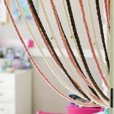 Kids can make a Jingling Finger Knit Door Drape once they learn the basics of finger knitting. This simple piece makes for a fun bedroom decoration that kids will love making in their spare time. Kids' knitting projects are simple and fun with this beautiful tutorial.