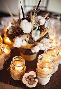 Love the rustic centerpiece, wheat, mason jars, wood, burlap