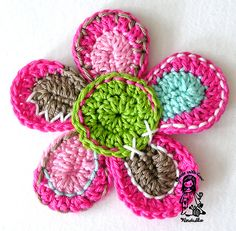 this flower goes on a crocheted cardigan!  Free pattern for cardigan and flower!