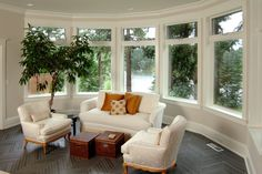 Sun room design in white with curved walls and windows, discovered on www.Porch.com