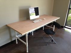 Table made from PVC costs $74 to make -- could adapt and have as a folding base for a desk/table for RV