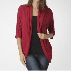 Bellino USA three-quarter sleeve open cardigan. Bellino USA three-quarter sleeve open cardigan. Gorgeous deep cranberry red color. Made in USA. 97% rayon, 3% spandex. Bellino Clothing Sweaters Cardigans