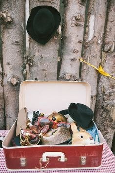 Provide Fun Reception Photo Props     Amp up your reception by providing a trunk full of props and accessories -- including animal masks, trendy glasses and fun headpieces -- for your guests to play with throughout the night.    Photography by  Brighton Photo . Image via  Boho Weddings .