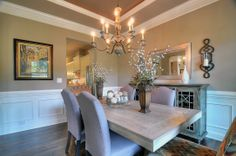 All of the beautiful crown molding gives this dining room a great look in our model home in the Enclaves at Crismark.