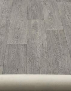 Our Real Woods range of high quality vinyl flooring brings realistic wood looks for contemporary and traditional homes, featuring a realistic bevel which gives the vinyl the effect of genuine wood planks the range is perfect for shower rooms, bathrooms, Vinyl Tiles, Wood Vinyl, Real Wood Floors, Wood Planks, Grey Vinyl Flooring, Engineered Oak Flooring, Grey Oak, Grey Pattern
