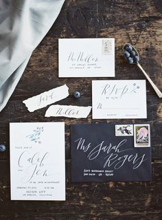 Downtown Los Angeles wedding invitation suite. Modern calligraphy by Script Merchant Calligraphy & Design to match the chic venue Hudson Loft. Black and white with vintage stamps. Gregory Ross Photography. Styling by Erin McDonald.
