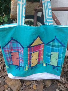 A personal favorite from my Etsy shop https://www.etsy.com/listing/243832137/beach-bag-large-tote-beach-huts