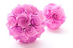 origami flower bombs! these are so cool.  I'm making them now to hang in my dorm room