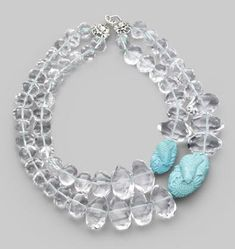 The Stephen Dweck Crystal & Turquoise Necklace is unique and stylish. This exquisite statement piece pairs chunky rock crystals and carved turquoise stones detailed with koi.
