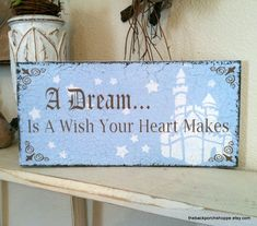 A DREAM Is A Wish Your Heart Makes 11 x 5 Shabby Cottage Cinderella Princess Pink or Blue Signs. $23.95, via Etsy.