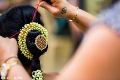 Getting ready. Traditional Southern Indian bride's bridal braid hair. Hairstyle by Swank Studio. #HairAccessory Find us at https://www.facebook.com/SwankStudioBangalore