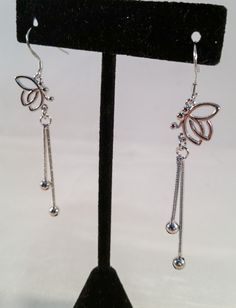 """Measuring 2.5"""" from French hook to tip, these butterfly earrings are simply adorable. Silver chain with silver beads trail the sterling charms."""