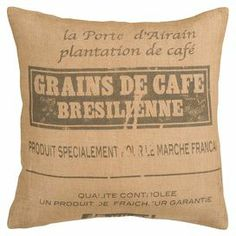 Throw pillow with a label motif. Product: PillowConstruction Material: JuteColor: Burlap and brownFeatures: Made in IndiaYour choice of down or polyester insert includedCleaning and Care: Blot stains